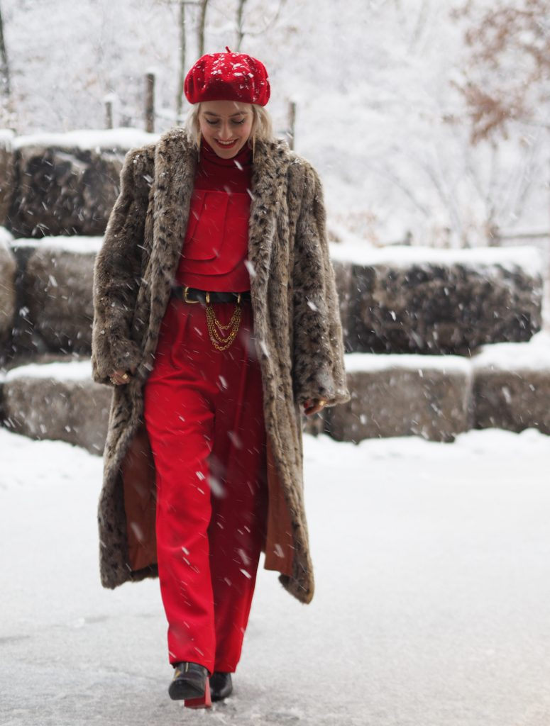 Office party holiday inspiration: a red jumpsuit with gold accessories