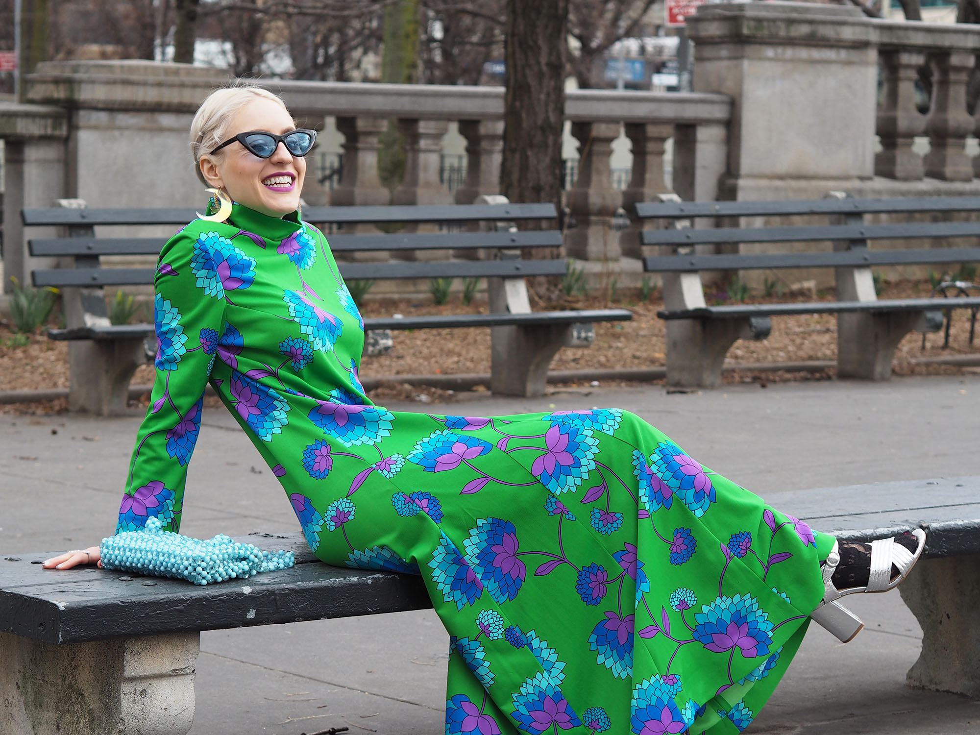 Ready for spring in this green floral maxi dress and beaded bag