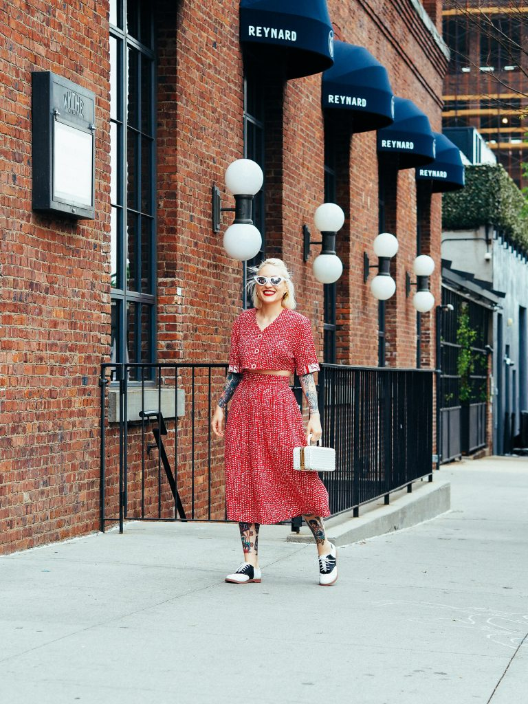 Retro vibes in saddle shoes and a red vintage co-ord